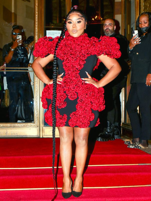 Lil' Kim Turns Heads In Red Mini Dress