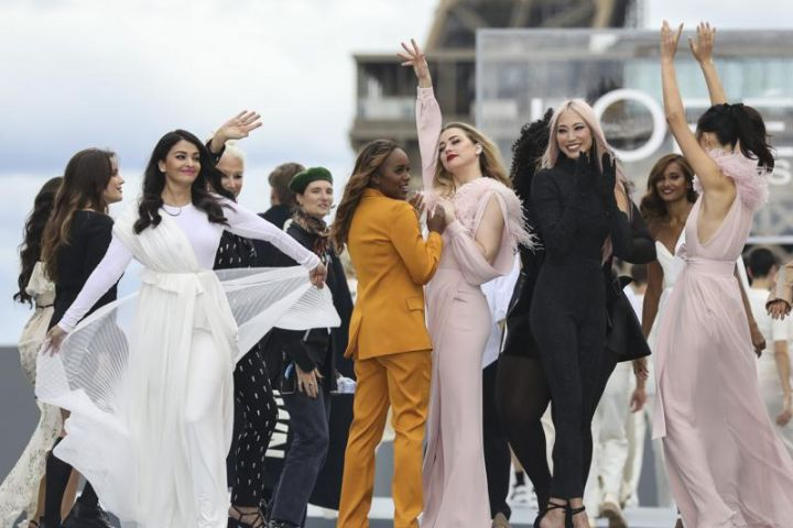 Aishwarya Rai Bachchan, from left, Helen Mirren and Amber Heard, fourth from left, wear creations for the L'Oreal Spring-Summer 2022 ready-to-wear fashion show presented in Paris, Sunday, Oct. 3, 2021. (Photo by Vianney Le Caer/Invision/AP)